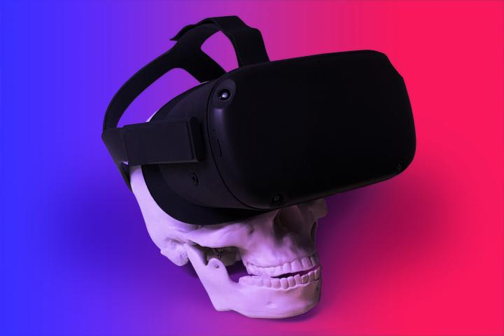 Skull wearing VR goggles on a pink to purple gradient background